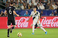 CARSON, CA - SEPTEMBER 15: Uriel Antuna #18 of the Los Angeles Galaxy stares down Ilie Sanchez #6 of Sporting Kansas City during a game between Sporting Kansas City and Los Angeles Galaxy at Dignity Health Sports Complex on September 15, 2019 in Carson, California.