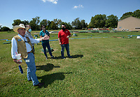 Heath Ward (from left), executive director of Springdale Water Utilities, speaks Friday, Aug. 21, 2020, with Al Drinkwater, a volunteer environmental quality consultant; Kim Patulak, human resources director for the city of Springdale; and Chris Clark, financial analyst for Springdale Water Utilities, as the four inspect the former Bethel Heights wastewater treatment facility. The Benton County Election Commission certified that the results of an Aug. 11 election to annex Bethel Heights into Springdale. Visit nwaonline.com/200823Daily/ for today's photo gallery.<br /> (NWA Democrat-Gazette/Andy Shupe)