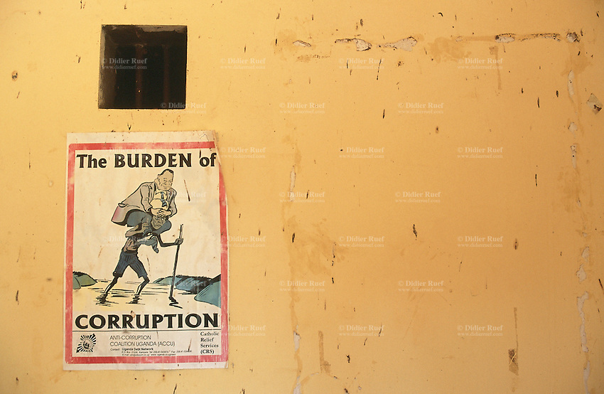 Uganda. Kayunga district. Baale. A poster for a campaign to fight the burden of corruption is taped on the wall of an administrative building. The campaign for Anti-Corruption is sponsored by the non-governmental organization (ngo) Catholic Relief Services (CRS). © 2004 Didier Ruef