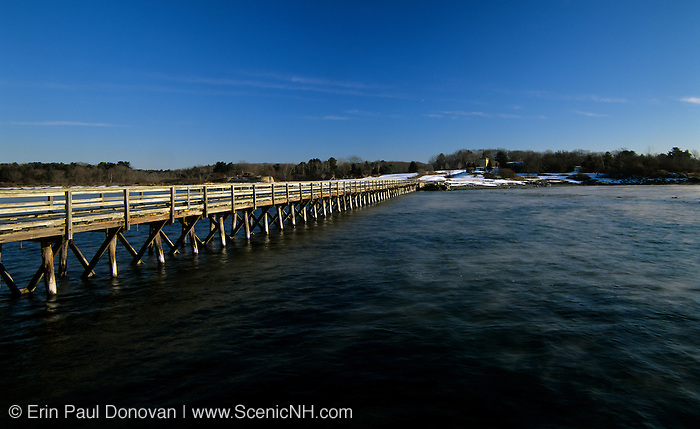 Long wooden wharf / pier at Fort Foster, which is located in Kittery, Maine USA, in Portsmouth Harbor, which is part of the New England seacoast.
