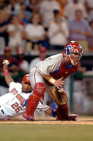 3 September 2005: Todd Pratt, catcher for the Philadelphia Phillies, is unable to tag the sliding Marlon Byrd, of the Washington Nationals. The Nationals defeated the Phillies 5-4 at RFK Stadium in Washington, DC. <br />