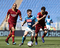 Football, Serie A: AS Roma - SSC Napoli, Olympic stadium, Rome, March 31, 2019. <br /> Napoli's Dries Mertens (c) in action with Roma's Federico Fazio (r) and Steven Nzonzi (l) during the Italian Serie A football match between Roma and Napoli at Olympic stadium in Rome, on March 31, 2019.<br /> UPDATE IMAGES PRESS/Isabella Bonotto