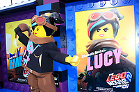 """LOS ANGELES - FEB 2:  Lucy character, poster at """"The Lego Movie 2: The Second Part"""" Premiere at the Village Theater on February 2, 2019 in Westwood, CA"""