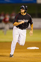Brent Tanner (43) of the Kannapolis Intimidators hustles towards third base against the Lakewood BlueClaws at CMC-Northeast Stadium on August 13, 2013 in Kannapolis, North Carolina.  The Intimidators defeated the BlueClaws 12-8.  (Brian Westerholt/Four Seam Images)