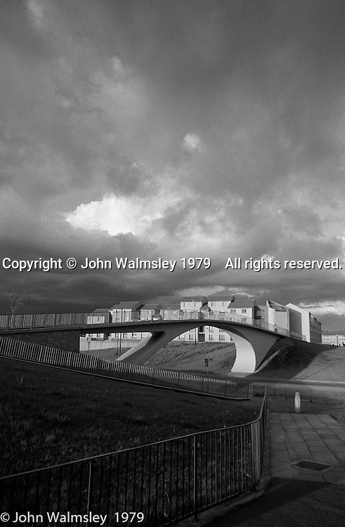 Elegant bridge in a storm, Wester Hailes, Scotland, 1979.  John Walmsley was Photographer in Residence at the Education Centre for three weeks in 1979.  The Education Centre was, at the time, Scotland's largest purpose built community High School open all day every day for all ages from primary to adults.  The town of Wester Hailes, a few miles to the south west of Edinburgh, was built in the early 1970s mostly of blocks of flats and high rises.