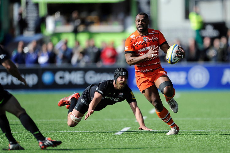 Vereniki Goneva of Leicester Tigers accelerates past Alistair Hargreaves of Saracens during the Aviva Premiership Rugby match between Saracens and Leicester Tigers at Allianz Park on Saturday 11th April 2015 (Photo by Rob Munro)