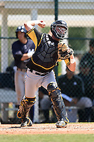 Pittsburgh Pirates catcher Reese McGuire (7) during a minor league spring training game against the New York Yankees on March 22, 2014 at Pirate City in Bradenton, Florida.  (Mike Janes/Four Seam Images)