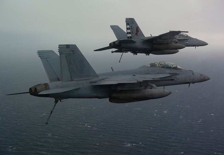 120225-N-DR144-1057 ARABIAN GULF (Feb. 25, 2012) An F/A-18F Super Hornet flown by Lt. j.g. Christopher Montague and Cmdr. Fernando Garcia, left, and an F/A-18F Super Hornet flown by Lt. Cmdr. Warren Tomlinson and Lt. j.g. Josh Raymond, right, all assigned to Strike Fighter Squadron (VFA) 22, enter the landing pattern over the Nimitz-class aircraft carrier USS Carl Vinson (CVN 70). Carl Vinson and Carrier Air Wing (CVW) 17 are deployed to the U.S. 5th Fleet area of responsibility.  (U.S. Navy photo by Mass Communication Specialist 2nd Class James R. Evans/Released).