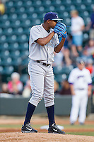 Wilmington Blue Rocks starting pitcher Miguel Almonte (27) looks to his catcher for the sign against the Winston-Salem Dash at BB&T Ballpark on April 3, 2014 in Winston-Salem, North Carolina.  The Blue Rocks defeated the Dash 3-1.  (Brian Westerholt/Four Seam Images)
