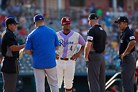 Umpires Luis Hernandez, Kyle Wallace, and Jose Matamoros during the lineup exchange with Frisco RoughRiders Andretty Cordeo (4) before a Texas League game against the Amarillo Sod Poodles on July 13, 2019 at Dr Pepper Ballpark in Frisco, Texas.  (Mike Augustin/Four Seam Images)