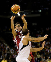 Turkish guard (13) Ender Arslan passes the ball over US Men's Basketball team guard (10) Deron Williams at the Cotai Arena in the Venetian Macau Hotel & Resort.  The US defeated Turkey, 114-82.