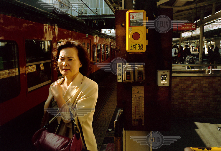 A commuter waiting to board a train.