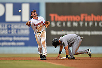 Asheville Tourists shortstop Ryan Vilade (4) makes the turn on a double play during a game against the Augusta GreenJackets on Crash Davis Night at McCormick Field on June 16, 2018 in Asheville, North Carolina. The GreenJackets defeated the Tourists 7-6. (Tony Farlow/Four Seam Images)