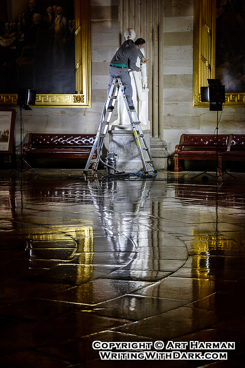 """""""Hamilton's Valet"""" by Art Harman. Late at night, the United States Capitol staff cleans and restores the history of our Capitol. This expert is cleaning the statue of Alexander Hamilton."""