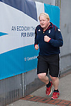 © Joel Goodman - 07973 332324 . 04/10/2016 . Birmingham , UK . BORIS JOHNSON goes for an early morning jog on the third day of the Conservative Party Conference at the International Convention Centre in Birmingham . Photo credit : Joel Goodman