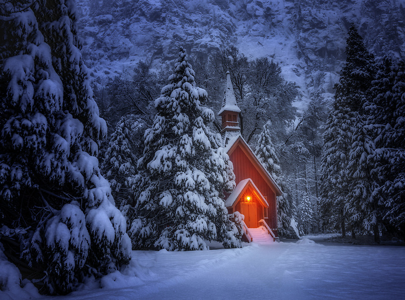 Snow covered church glows at blue hour. Yoesmite National Park, CA