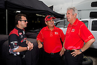Sept. 1, 2013; Clermont, IN, USA: Crew chief Lee Beard (right) talks with NHRA top fuel dragster drivers Billy Torrence (center) and Steve Torrence during qualifying for the US Nationals at Lucas Oil Raceway. Mandatory Credit: Mark J. Rebilas-