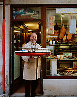 Gilberto Penzo proudly poses with one of his creations. Situated just a  two-minute walk from the Basilica di Santa Maria Gloriosa dei Frari, Penzo creates exquisitely detailed model boats.