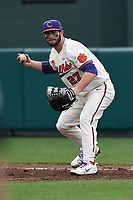 First baseman Chris Williams (27) of the Clemson Tigers makes a putout in a game against the Furman Paladins on Tuesday, February 20, 2018, at Doug Kingsmore Stadium in Clemson, South Carolina. Clemson won, 12-4. (Tom Priddy/Four Seam Images)
