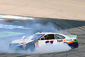 #11: Denny Hamlin, Joe Gibbs Racing, Toyota Camry FedEx Ground, does a burnout after winning