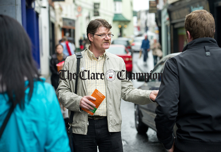 European election candidate Diarmuid O Flynn of the Ballyhea Campaign Group canvassing voters on O Connell Street, Ennis on Wednesday. Photograph by John Kelly.