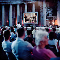 At a service in St Peter's Square at the Vatican in Rome, the Heereman family from Germany shown on the large television screen give a testimony in front of the Pope and 15,000 people. They were presented as an example of a devout family. One of the sons is a priest of the Legionaries of Christ, one daughter is a consecrated virgin of Regnum Christi (the lay apostolic movement of the Legionaries of Christ), and two other sons are married with children. The Legion of Christ is a conservative Roman Catholic congregation whose members take vows of chastity, obedience and poverty.