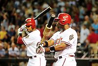 Jun. 22, 2010; Phoenix, AZ, USA; Arizona Diamondbacks outfielders Justin Upton (right) and Chris Young warm up in the eighth inning against the New York Yankees at Chase Field. The Yankees defeated the Diamondbacks 9-3. Mandatory Credit: Mark J. Rebilas-