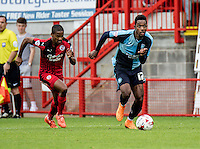 Jason Banton of Wycombe Wanderers gets away from Lewis Young of Crawley Town during the Sky Bet League 2 match between Crawley Town and Wycombe Wanderers at Checkatrade.com Stadium, Crawley, England on 29 August 2015. Photo by Liam McAvoy.