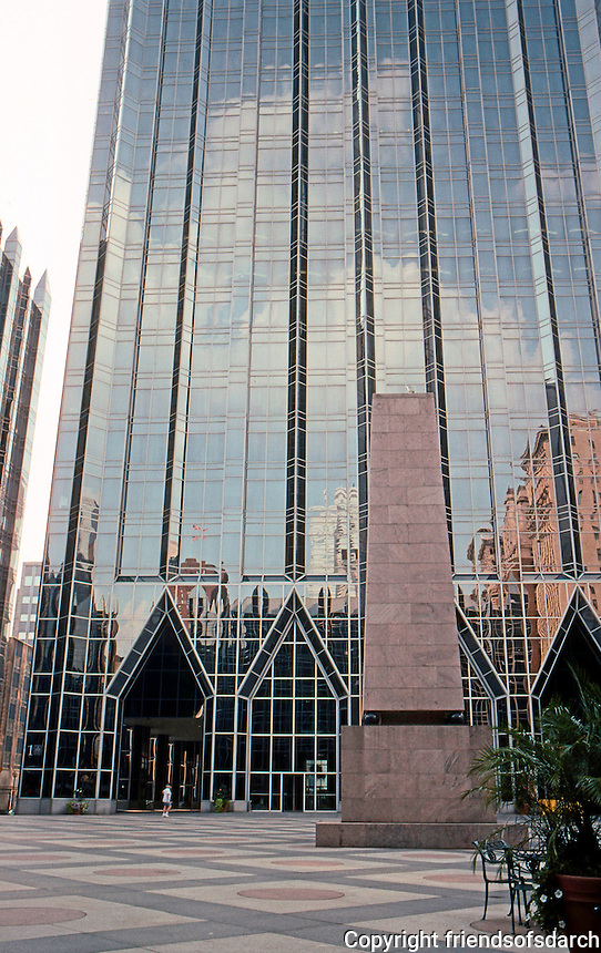 """Philip Johnson & John Burgee: PPG Place. The obelisk in front has been called """"The Tower of the Unknown Bowler. ( The Tower has 20,000 sheets of glass.)   Photo '01."""