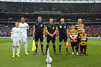 Pictured: Ashley Williams (L) and Gary Jones (R) with Children mascots and the referees. Sunday 24 February 2013<br /> Re: Capital One Cup football final, Swansea v Bradford at the Wembley Stadium in London.