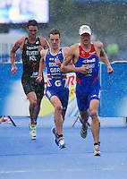 07 AUG 2011 - LONDON, GBR - Alistair Brownlee (GBR) (centre) follows Alexander Bryukhankov (RUS) from transition at the start of the run during the men's round of triathlon's ITU World Championship Series (PHOTO (C) NIGEL FARROW)