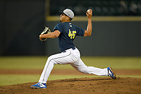 Starting pitcher Jose Butto (45) of the Columbia Fireflies delivers a pitch in a game against the Charleston RiverDogs on Friday, April 5, 2019, at Segra Park in Columbia, South Carolina. Charleston won, 6-1. (Tom Priddy/Four Seam Images)