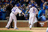 Chicago Cubs David Ross (3) high fives Jon Lester (34) after an RBI sac fly in the fourth inning during Game 5 of the Major League Baseball World Series against the Cleveland Indians on October 30, 2016 at Wrigley Field in Chicago, Illinois.  (Mike Janes/Four Seam Images)