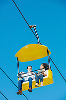 South Bend mayor and Democratic presidential candidate Pete Buttigieg rides the Sky Glider with Des Moines Register statehouse and politics reporter Barbara Rodriguez at the Iowa State Fair in Des Moines, Iowa, on Tues., Aug. 13, 2019.