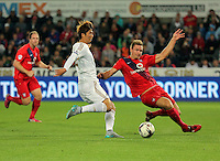 Pictured L-R: Ki Sung Yueng of Swansea against Dave Winfield of York  Tuesday 25 August 2015<br /> Re: Capital One Cup, Round Two, Swansea City v York City at the Liberty Stadium, Swansea, UK.