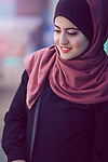 A girl wearing veil (hijab) with smile. Photo by Sanad Ltefa