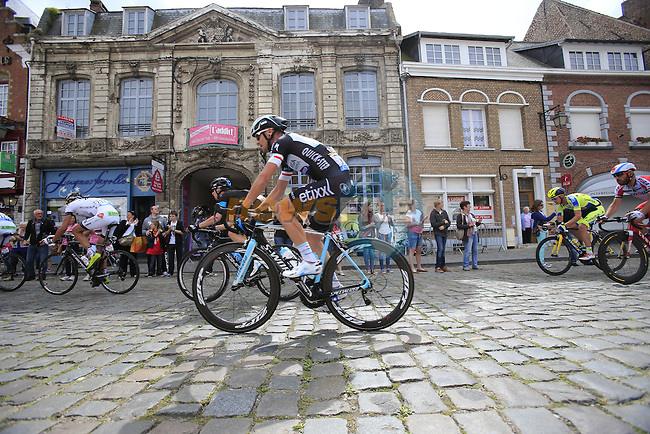 The peleton including Michal Golas (POL) Omega Pharma-Quick Step pass through the ancient town of Cassel during Stage 4 of the 2014 Tour de France running 163.5km from Le Touquet to Lille. 8th July 2014.<br /> Picture: Eoin Clarke www.newsfile.ie
