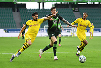 23rd May 2020, Volkswagen Arena, Wolfsburg, Lower Saxony, Germany; Bundesliga football,VfL Wolfsburg versus Borussia Dortmund; Emre Can challenges Wout Weghorst of Wolfsburg