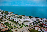 A postcard from the 1960s depicting an aerial view of the Grand Hotel. Once a luxury destination for the wealthy and the continent's biggest hotel, the building is now a concrete shell and home to about 6,000 squatters. Those unable to occupy one of the rooms sleep in the corridors, basements and even on the roof of the building.