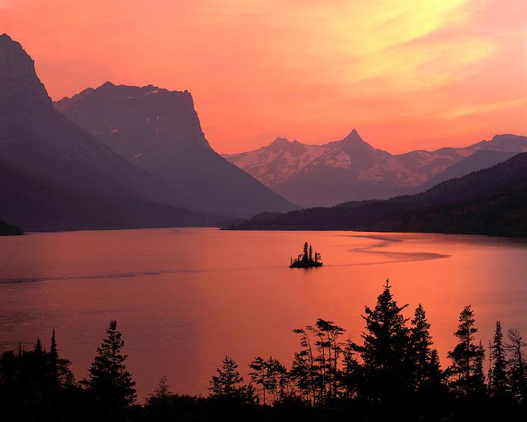 Sunset glow on Saint Mary Lake and Wild Goose Island; Glacier National Park, MT