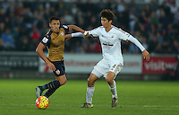 Alexis Sanchez of Arsenal and Ki Sung-Yueng of Swansea City during the Barclays Premier League match between Swansea City and Arsenal played at The Liberty Stadium, Swansea on October 31st 2015