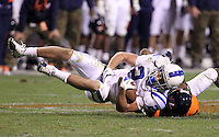 CHARLOTTESVILLE, VA- NOVEMBER 12: Wide receiver Conner Vernon #2 of the Duke Blue Devils is tackled by cornerback Chase Minnifield #13 of the Virginia Cavaliers during the game on November 12, 2011 at Scott Stadium in Charlottesville, Virginia. Virginia defeated Duke 31-21. (Photo by Andrew Shurtleff/Getty Images) *** Local Caption *** Conner Vernon;Chase Minnifield