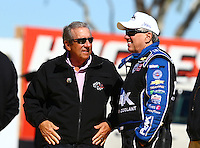 Feb 3, 2016; Chandler, AZ, USA; NHRA team owner Don Schumacher (left) talks with funny car driver John Force during pre season testing at Wild Horse Pass Motorsports Park. Mandatory Credit: Mark J. Rebilas-USA TODAY Sports