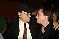 Serge Losique (L) talk with Louis Belanger, Finalists  at Genies 2004, in April 2004<br /> <br />  File Photo Agence Quebec Presse - Pierre Roussel