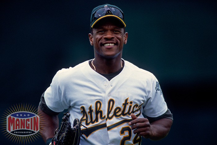 OAKLAND, CA - Rickey Henderson of the Oakland Athletics runs to the dugout during a game at the Oakland Coliseum in Oakland, California in 1998. (Photo by Brad Mangin)