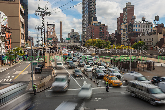 Mid-day traffic enters Manhattan from Queens on the Queensboro Bridge in New York City.