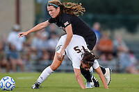 Texas midfielder Julia Dyche (5) and Texas State midfielder Maddie Nichols (15) fight for ball possession during the first half of an NCAA soccer game, Sunday, September 21, 2014 in San Marcos, Tex. Texas defeated Texas State 2-0. (Mo Khursheed/TFV Media via AP Images)