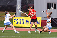 Emily Garrity (22) and Katy Fitzgerald (28) of North Carolina move to defend Laura Merrifield (9) of Maryland during the ACC women's lacrosse tournament finals in College Park, MD.  Maryland defeated North Carolina, 10-5.