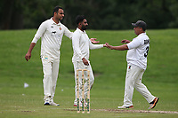 Newham players celebrate the third Ardleigh Green wicket during Ardleigh Green & Havering-Atte-Bower CC (batting) vs Newham CC, Hamro Foundation Essex League Cricket at Central Park on 10th July 2021