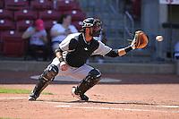 Clinton LumberKings Arturo Nieto (23) catches during the game against the Cedar Rapids Kernels at Veterans Memorial Stadium on April 17, 2016 in Cedar Rapids, Iowa.  Clinton won 7-2.  (Dennis Hubbard/Four Seam Images)